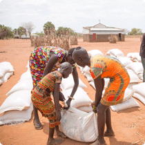 East Africa Food Crisis Siblings Assist Each Other To Carry A Sack Of Food Received